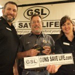 Bob Taft, center, won the Ruger LCR provided by TK Custom Store in Thomasboro.  He's with GSL's President Bear St. Pierre and Vice-President Adrienne Logue.