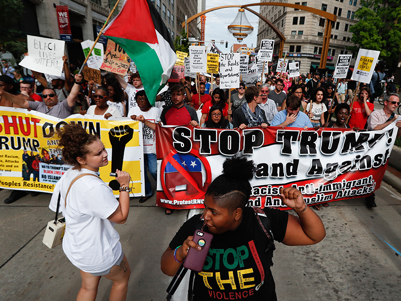 KEEPIN' IT CLASSY OUTSIDE THE RNC:  KKK, Black Lives Matter and Westboro Church throw urine on one another; armed Trump supporters left alone