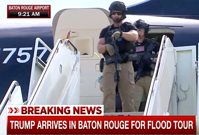 TRUMP IN BATON ROUGE:  Trump's ready for anything while helping people.  Clinton is resting, Obama's vacationing
